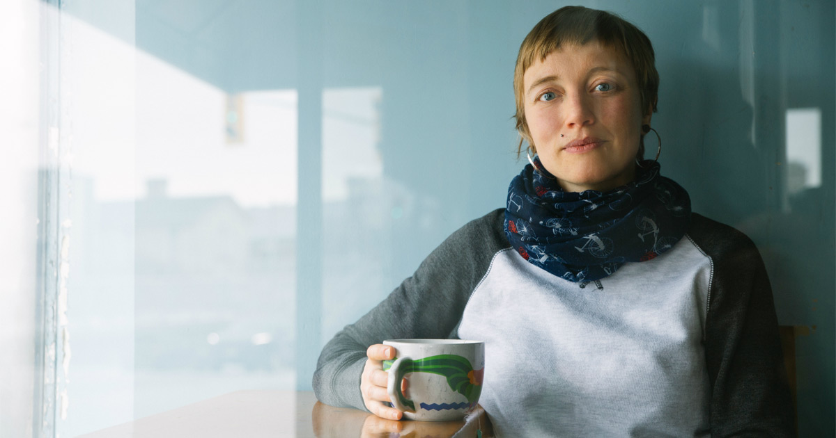 Lisa Baird sits down with a cup of tea.